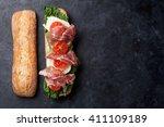 ciabatta sandwich with romaine... | Shutterstock . vector #411109189