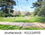 defocused people at park ... | Shutterstock . vector #411116935