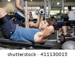 handsome man working his abs in ... | Shutterstock . vector #411130015