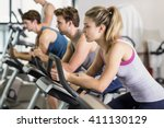 fit people doing exercise bike... | Shutterstock . vector #411130129