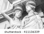 Caryatid. Statues Of Two Young...