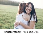 two young women hugging... | Shutterstock . vector #411156241