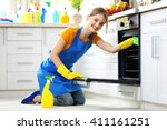 cleaning concept. woman washes... | Shutterstock . vector #411161251