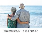 senior couple facing the sea at ... | Shutterstock . vector #411170647