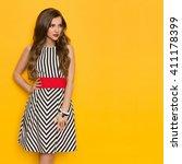 beautiful young woman in black...   Shutterstock . vector #411178399