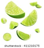falling limes isolated on white | Shutterstock . vector #411210175