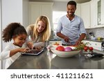 mum and daughter use tablet... | Shutterstock . vector #411211621