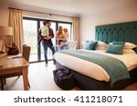 Stock photo family arriving in hotel room on vacation 411218071