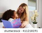 caucasian mum and black... | Shutterstock . vector #411218191