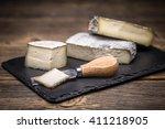 piece of artisan brie cream... | Shutterstock . vector #411218905