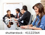 business woman on a laptop in a business meeting - stock photo