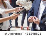 reporters making interview with ... | Shutterstock . vector #411248821