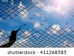 silhouette hand with scissors... | Shutterstock . vector #411268585