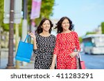 happy twin sisters doing... | Shutterstock . vector #411283291