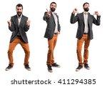 man doing victory gesture | Shutterstock . vector #411294385