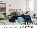 shot of a bed in a spacious... | Shutterstock . vector #411307039