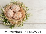nest with eggs on wooden... | Shutterstock . vector #411369721