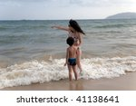 mother and son on the beach | Shutterstock . vector #41138641