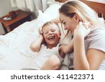 young mother with her 6 years... | Shutterstock . vector #411422371