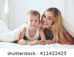 young mother with her 6 years... | Shutterstock . vector #411422425