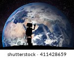 robot looking on the planet... | Shutterstock . vector #411428659