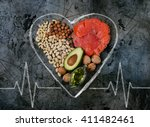 healthy fats for heart on dark... | Shutterstock . vector #411482461