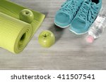 yoga mat with sport shoes and... | Shutterstock . vector #411507541