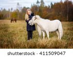 blond girl with long hair with... | Shutterstock . vector #411509047