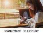 asian girl using smartphone in... | Shutterstock . vector #411544009