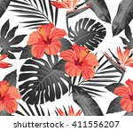 tropical flowers and leaves on... | Shutterstock .eps vector #411556207