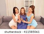 pretty girls sitting on sofa... | Shutterstock . vector #411585061