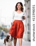 Young Woman Walking Her Dog An...