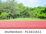 Empty Table With Red Tableclot...