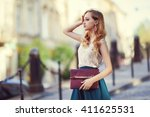 outdoor portrait of a young... | Shutterstock . vector #411625531
