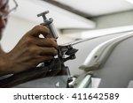a man using repairing equipment ... | Shutterstock . vector #411642589
