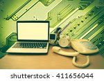 laptop and telephone with board ... | Shutterstock . vector #411656044