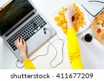 pretty young woman working at... | Shutterstock . vector #411677209