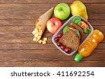 kid school lunch on wooden... | Shutterstock . vector #411692254