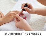 hands of master applying... | Shutterstock . vector #411706831