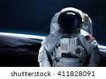 astronaut in outer space.... | Shutterstock . vector #411828091
