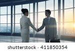 business partners handshake | Shutterstock . vector #411850354