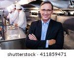 male restaurant manager... | Shutterstock . vector #411859471