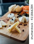 cheese set on the wood board    Shutterstock . vector #411866284