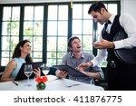 waiter taking an order for a... | Shutterstock . vector #411876775