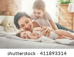 happy loving family. mother and ... | Shutterstock . vector #411893314