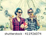 2 women shouting with... | Shutterstock . vector #411926074