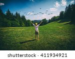 Young Girl Standing On Green...