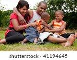 happy black family enjoying...   Shutterstock . vector #41194645