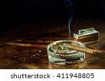 Smoking Cigar Sitting In Round...