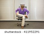 man exercising on chair in... | Shutterstock . vector #411952291